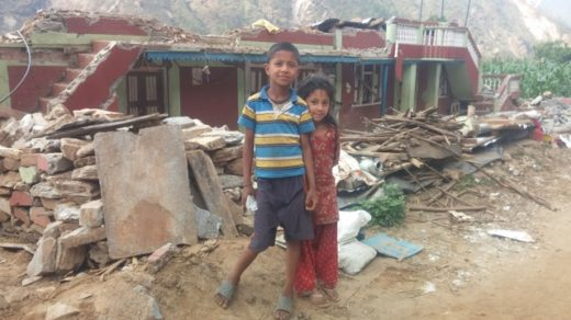 Bro and sis in front of their house